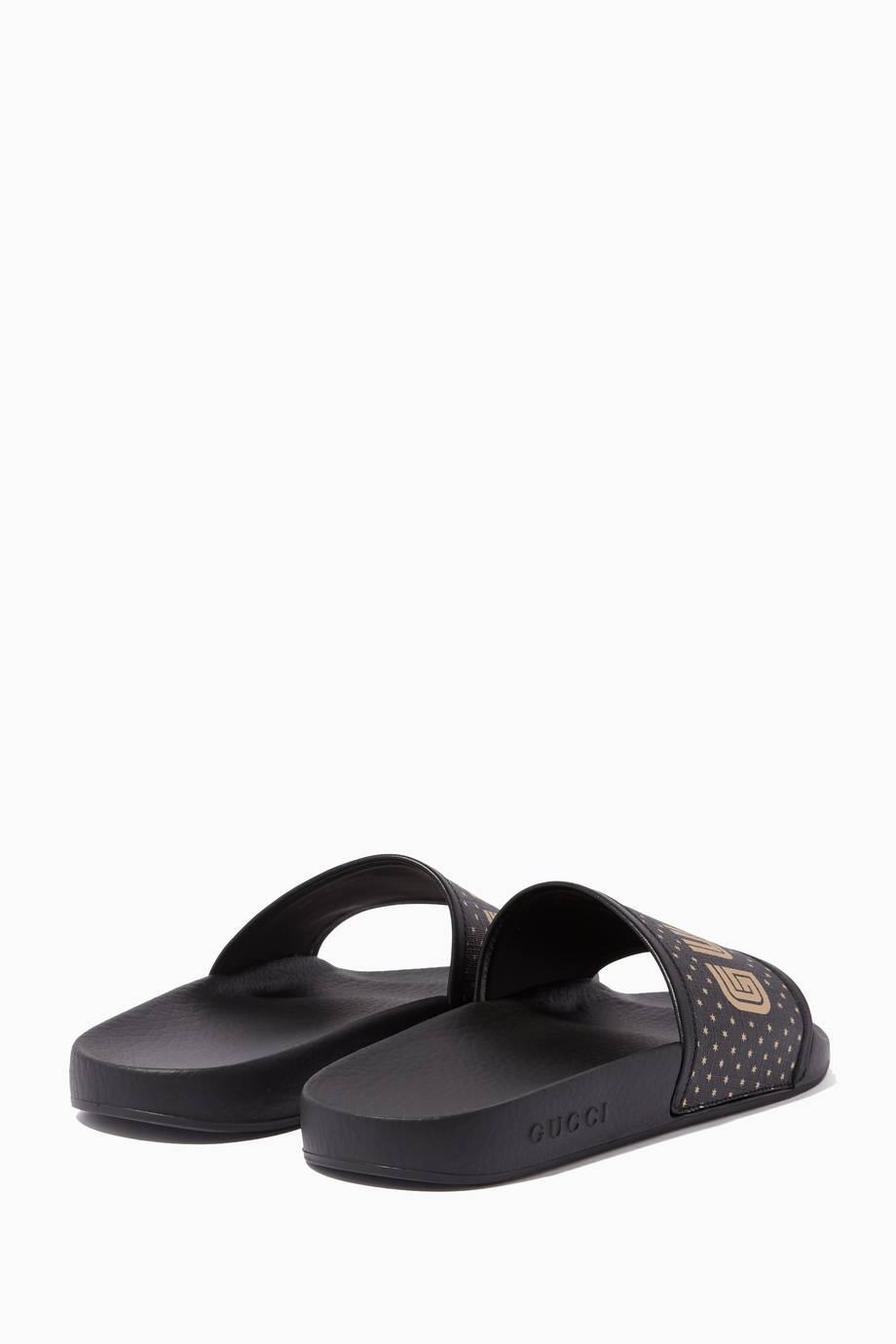 6c2bf3ccaf0 Shop Luxury Gucci Black Pursuit Guccy Rubber Slides
