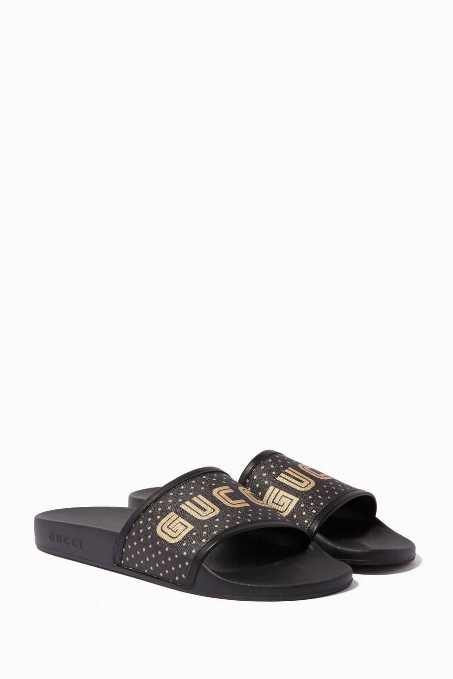 83d6fd8ac371 Shop Luxury Gucci Black Pursuit Guccy Rubber Slides